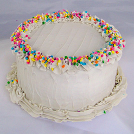 Small Vanilla Frosted Birthday Cake with Pastel Sprinkles