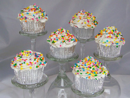 Cupcakes with Vanilla Frosting and Pastel Sprinkles