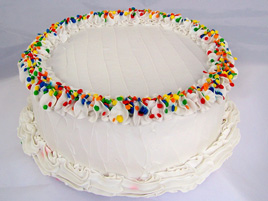 Large Vanilla Frosted Birthday Cake with Primary Sprinkles